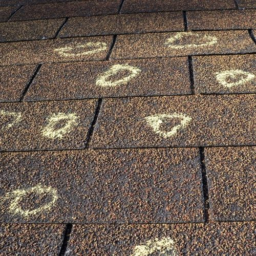 A Picture of a Hail Damaged Roof That Has Been Marked Up By an Insurance Adjuster.