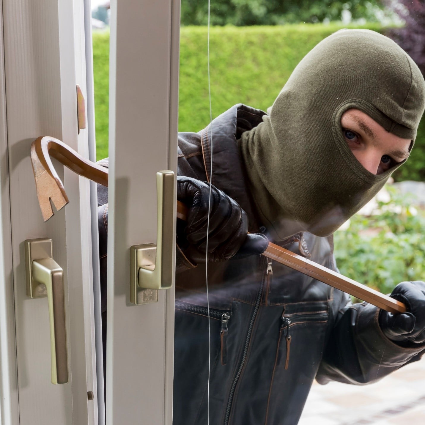 man breaking in to home with a crowbar